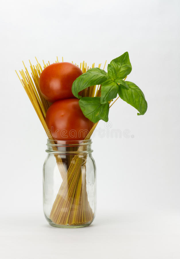 Tomatoes basil and pasta royalty free stock image
