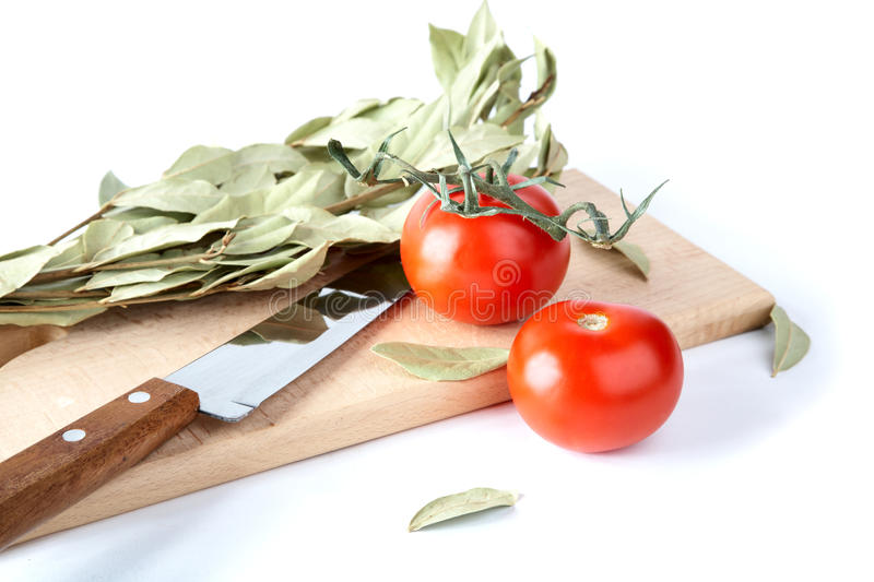 Tomatoes And Bay Leaf Branches Stock Images