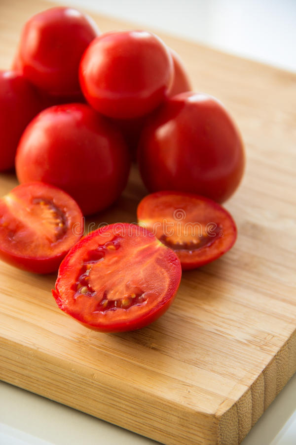Tomatoes on the board royalty free stock photo