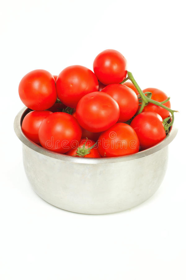 Tomatoes in a bowl stock image