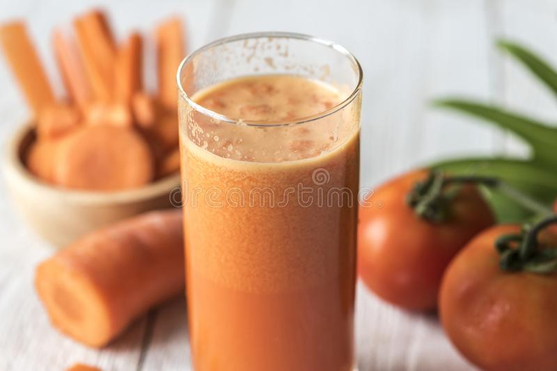 Tomatoes and Carrot Juice on Highball Glass stock photography