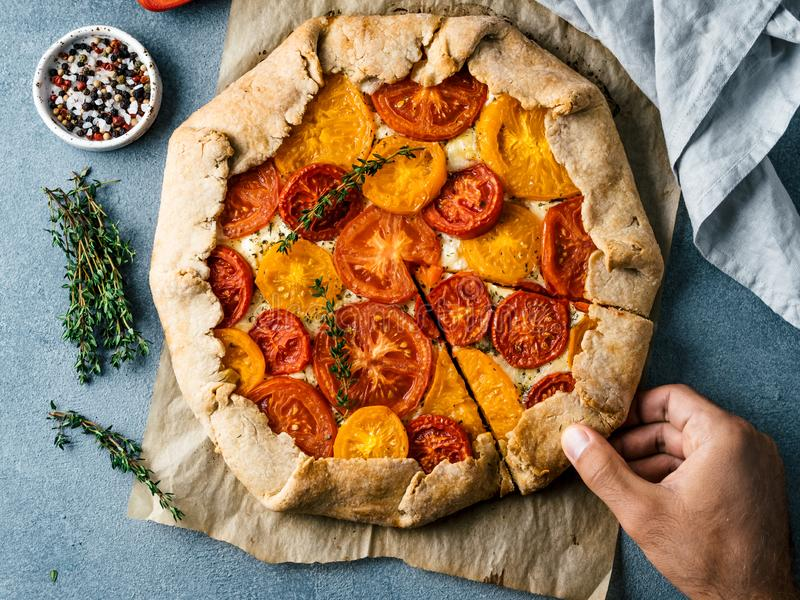 Tomatoes and cheese tart or galette royalty free stock photo