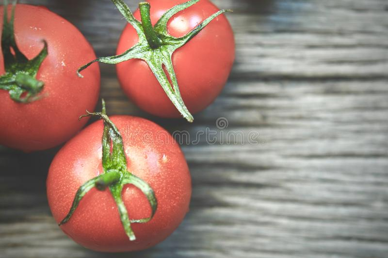 Tomatoes, cooked for the preservation on the old wooden table. Organic food, Cherry tomatoes on wood. stock photo
