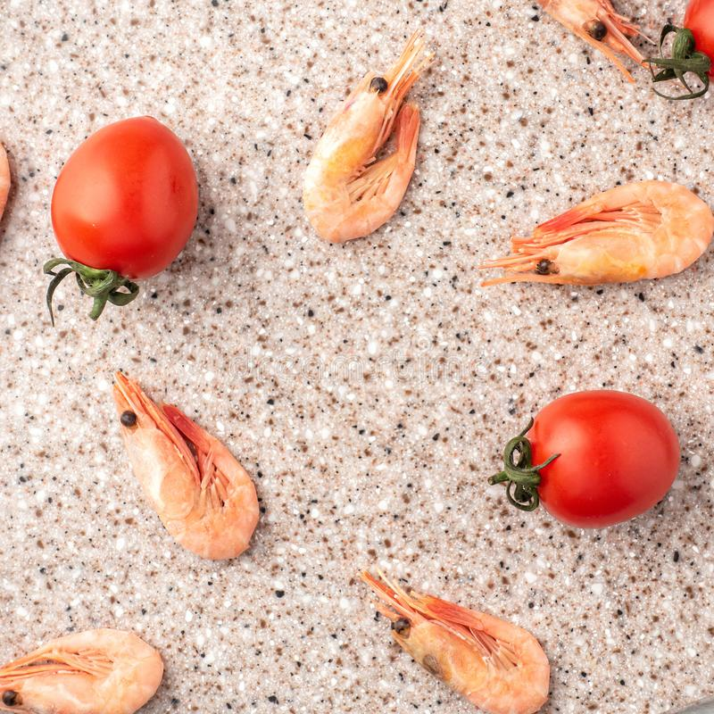 Tomatoes and curves on a kitchen cutting board made of artificial stone.  stock photography