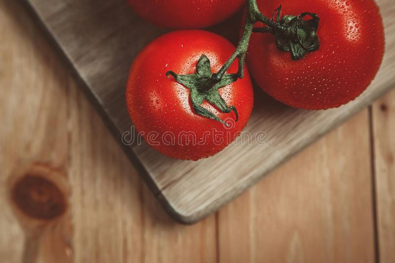 Tomatoes on cutting board stock photography