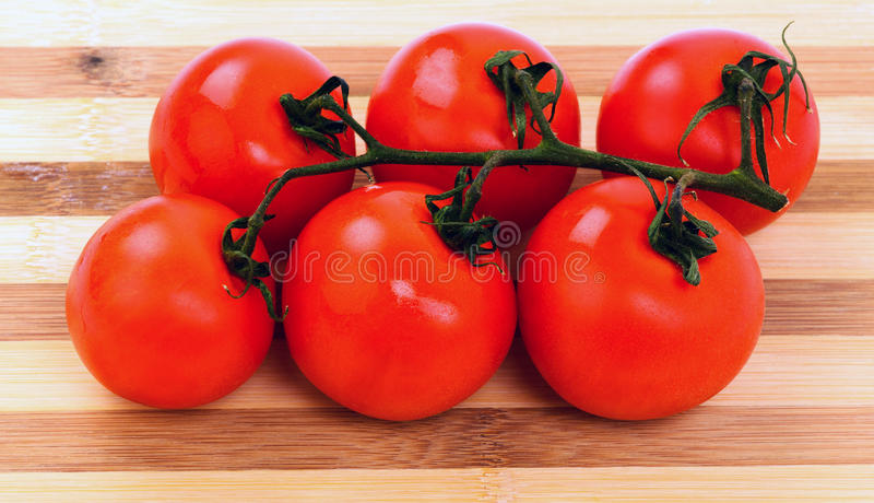 Download Tomatoes On A Cutting Board Isolated On White Background Stock Photo - Image: 30859422