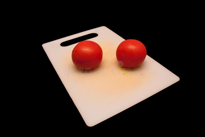 Tomatoes on a cutting board stock photos