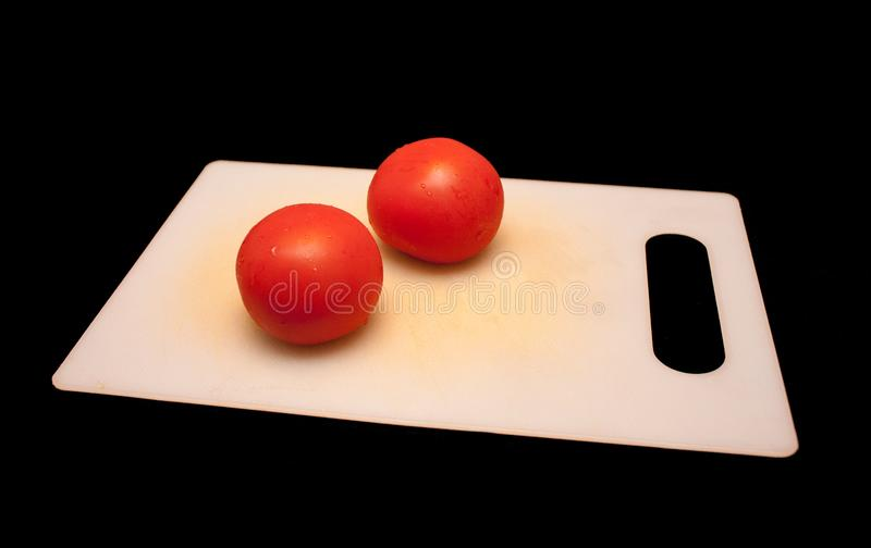Tomatoes on a cutting board stock photo