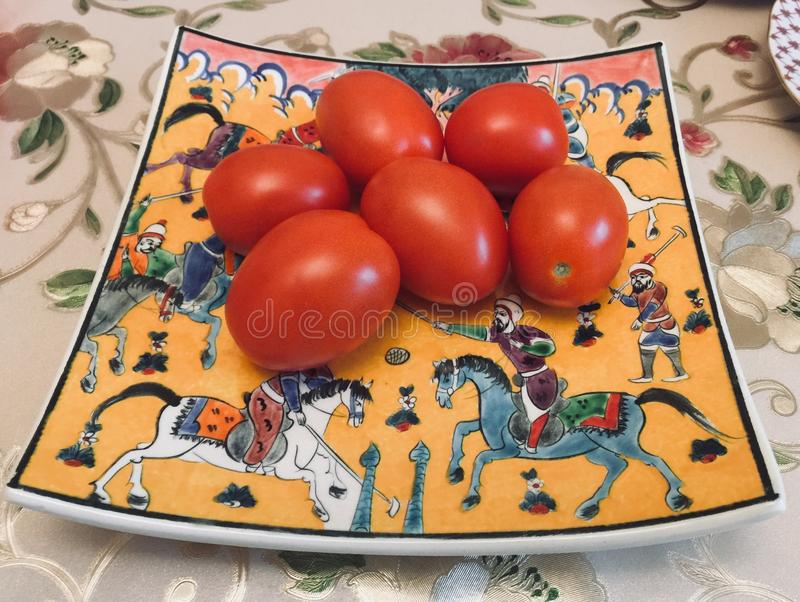 Tomatoes on the dish royalty free stock photo