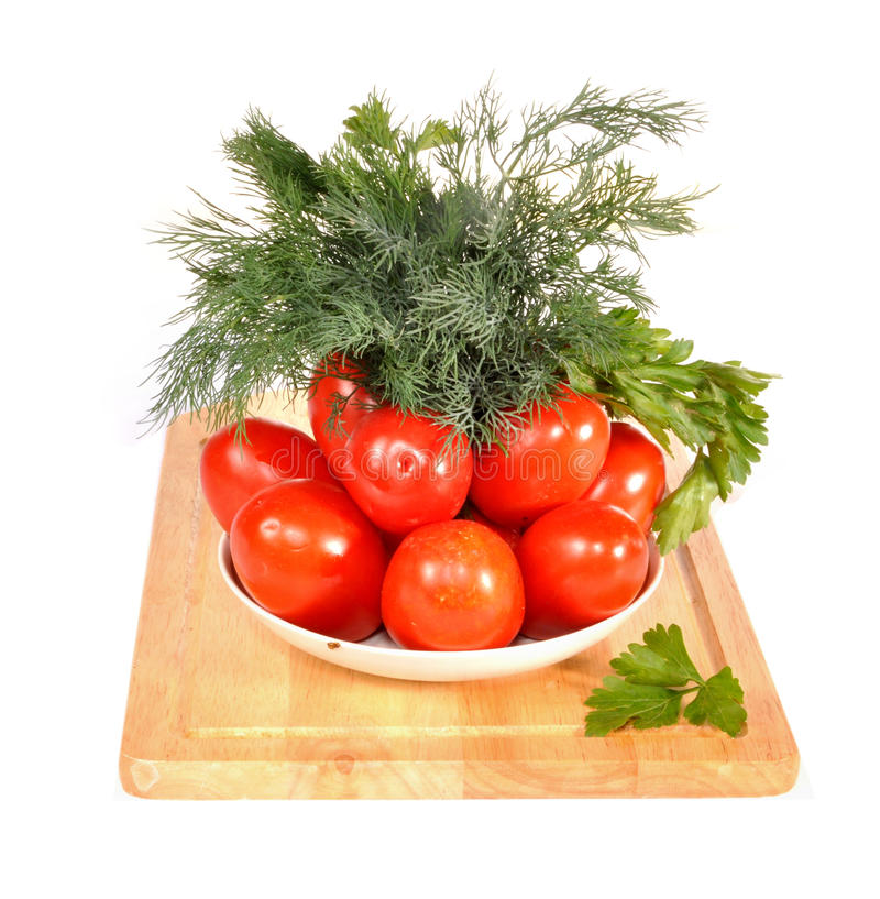 Tomatoes, fennel on a saucer on a table stock photos