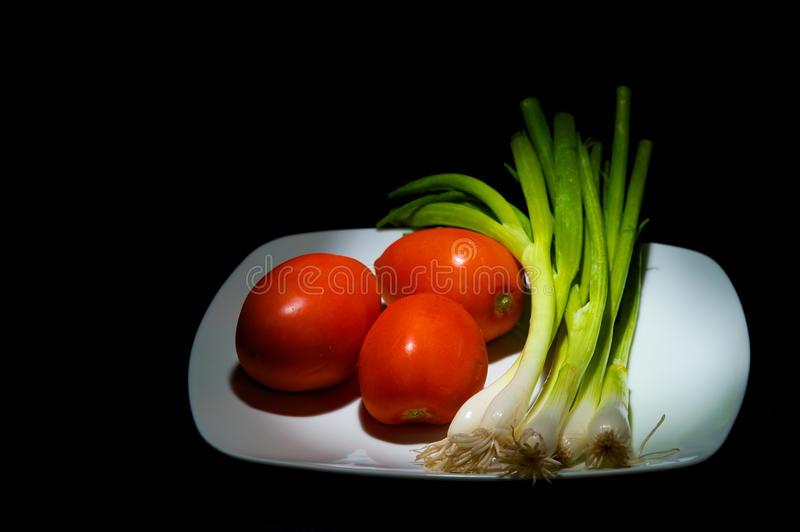 Download Tomatoes and Geen Oinions stock image. Image of food - 24867865