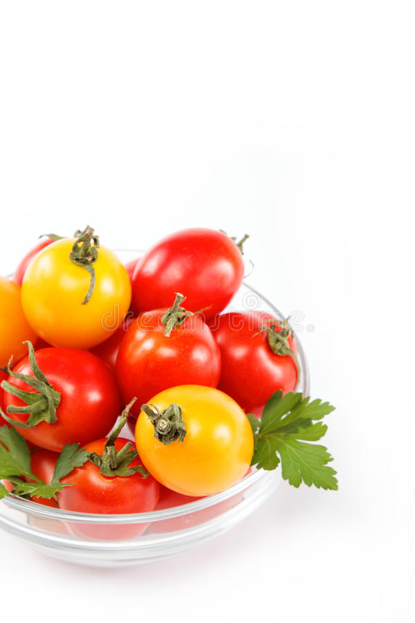Download Tomatoes In A Glass Isolated On A White. Royalty Free Stock Photos - Image: 26543548