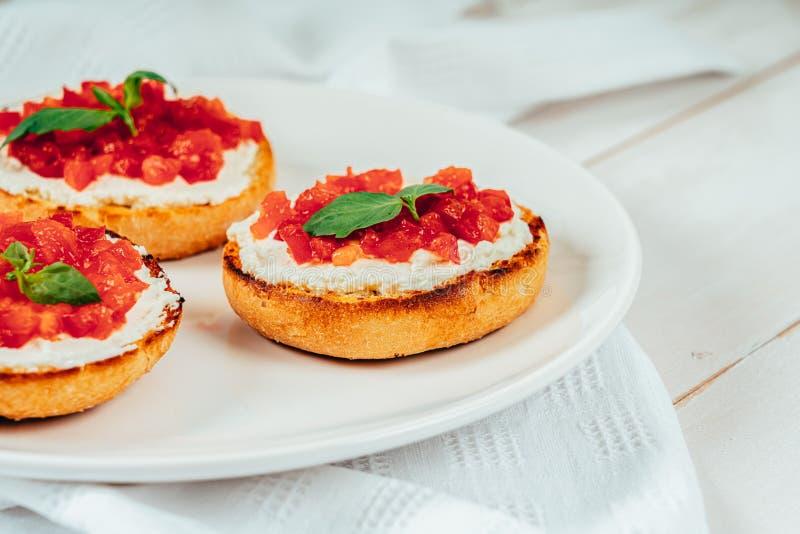Tomato And Goat Cheese Bruschetti. Tomatoes And Goat Cheese Bruschetti stock photography