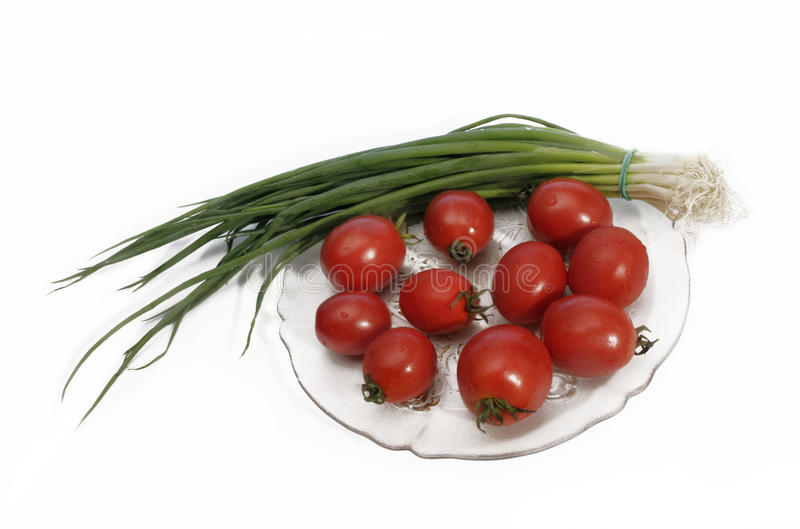 Tomatoes and green onion royalty free stock photography