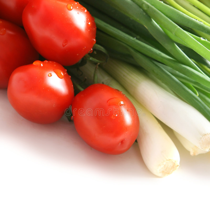 Tomatoes and green onions royalty free stock photography