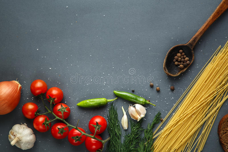 Tomatoes with green pappers and herbs stock image
