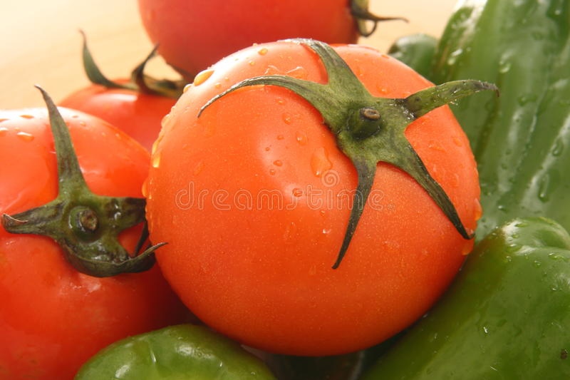 Tomatoes And Green Peppers Royalty Free Stock Photos