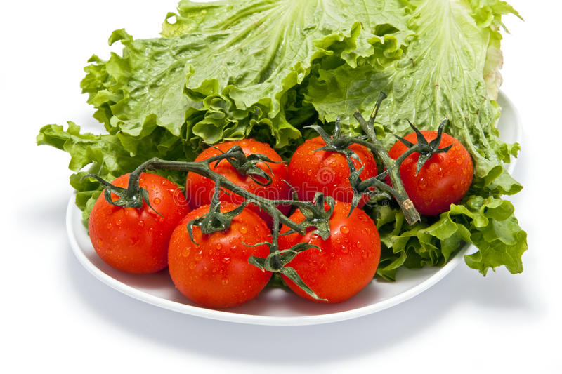 Download Tomatoes And Lettuce On A Plate Royalty Free Stock Photos - Image: 13472458