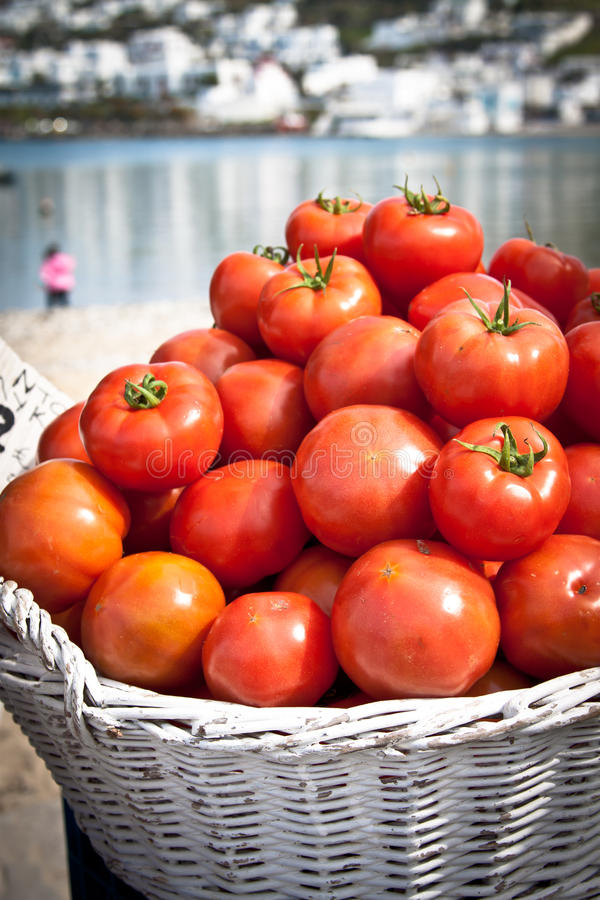Tomatoes at market on the beach royalty free stock photography