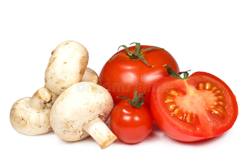 Tomatoes and mushrooms. Isolated on white background stock images