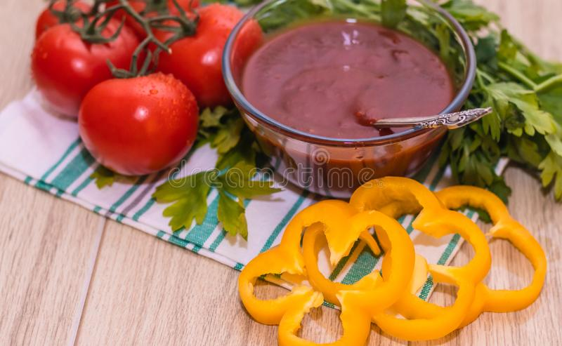 Tomatoes paste with tomatoes on wooden tables royalty free stock photos