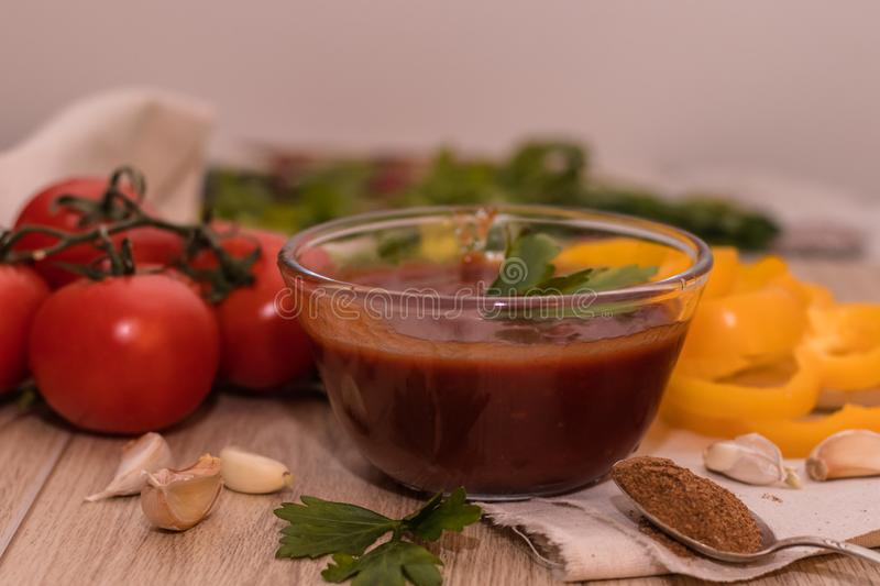 Tomatoes paste with tomatoes on wooden tables stock photo
