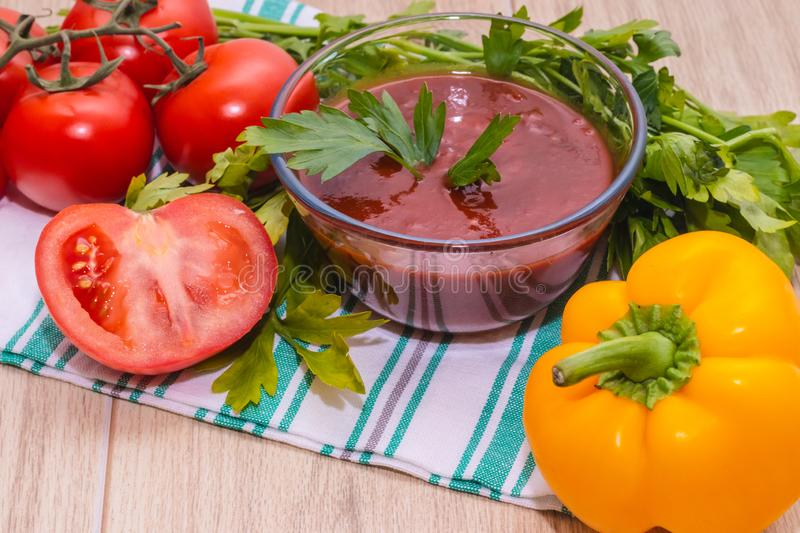 Tomatoes paste with tomatoes on wooden tables royalty free stock photo