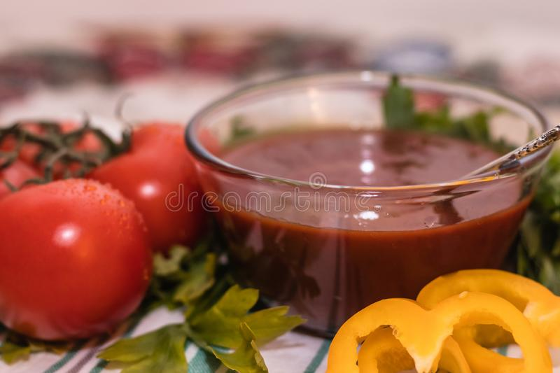 Tomatoes paste with tomatoes on wooden tables stock photography