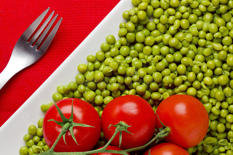 Tomatoes And Peas Stock Photos