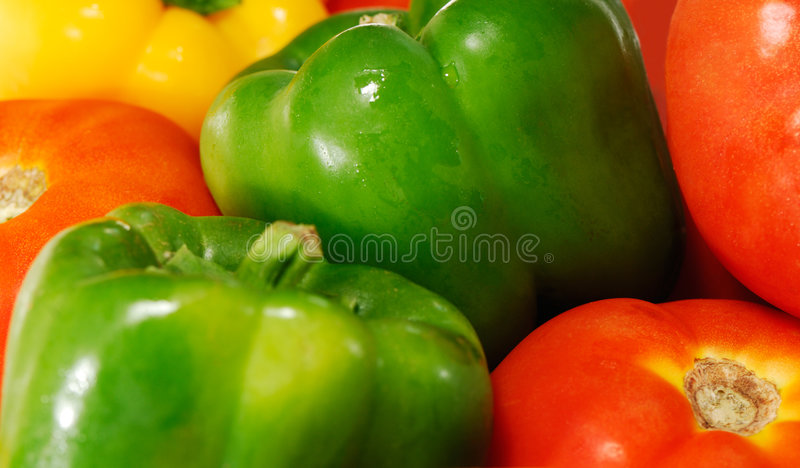 Tomatoes and peppers stock photos