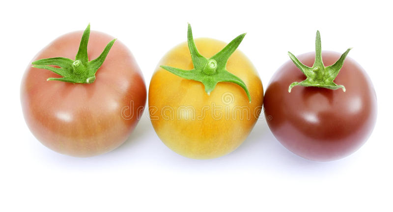Tomatoes pink, yellow and red. Isolated on white stock photos