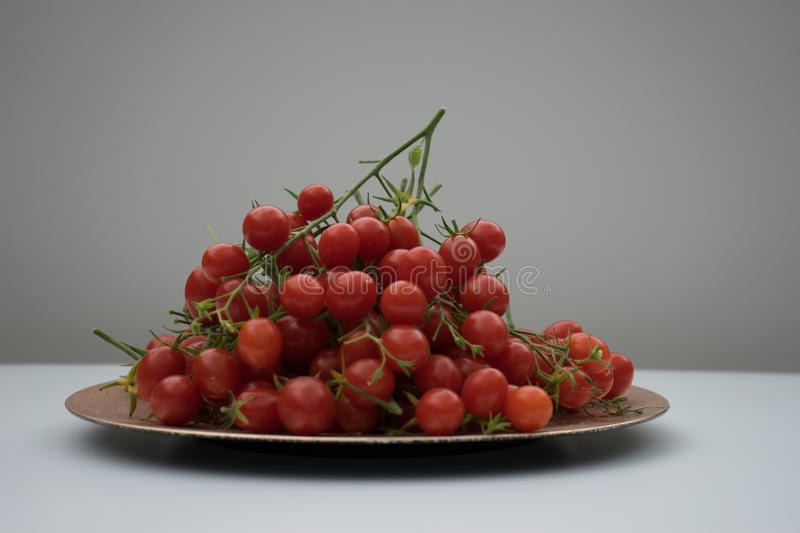 Tomatoes. A plate of tomatoes, ready for consumption royalty free stock images