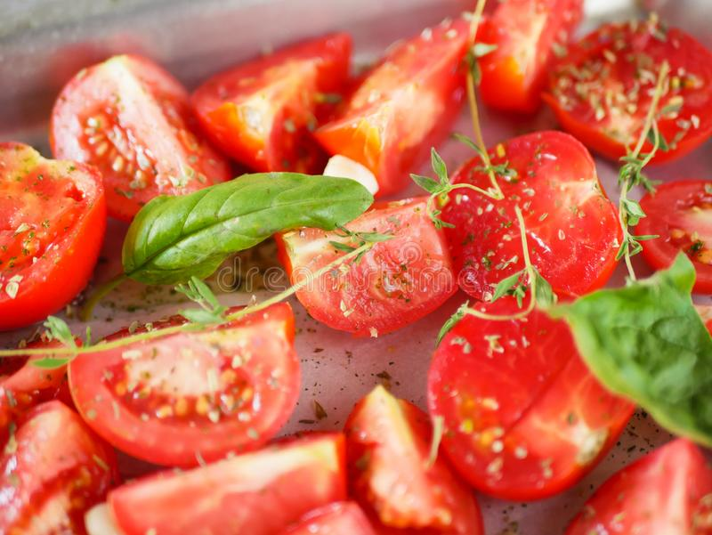 Tomatoes with provencal herbs, basil, thyme, and garlic. Vegetarian ratatouille from eggplants, zucchini, tomatoes and bell pepper. Sauce and tomato with herbs royalty free stock images