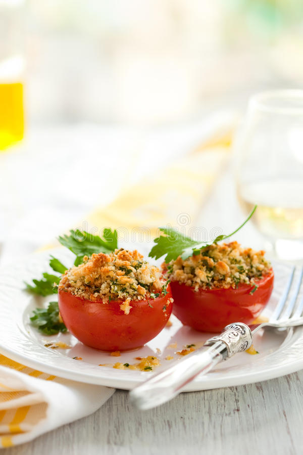 Tomatoes provencal style. Provencal style baked tomatoes on the plate stock images