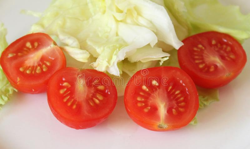 Tomatoes and salad stock photo