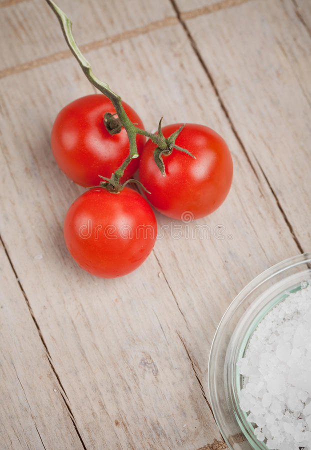 Download Tomatoes and salt stock image. Image of ripe, board, eating - 24325525