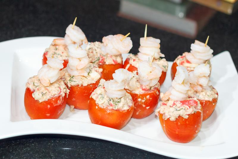 Tomatoes stuffed with crab meat stock photo