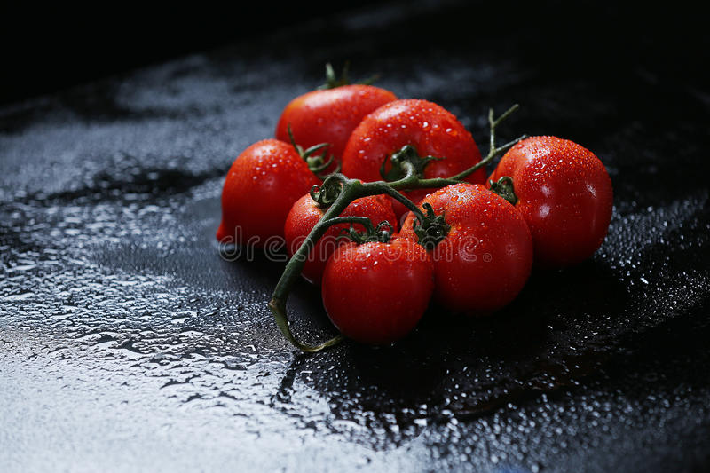 Tomatoes under water drops stock photo