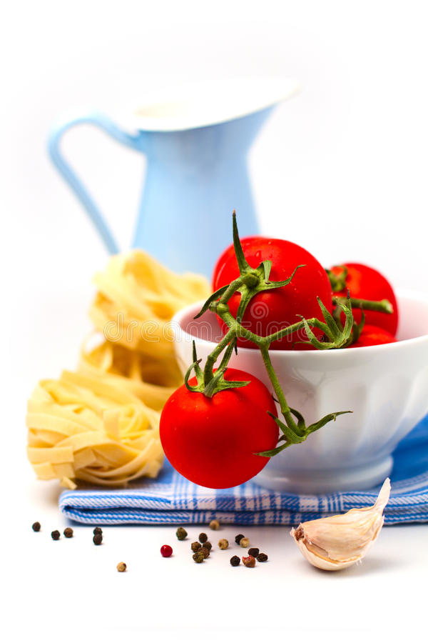Tomatoes In White Bowl And Pasta Royalty Free Stock Photography
