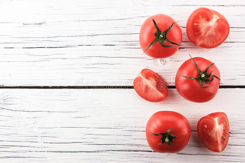 Tomatoes on white wooden board stock photo