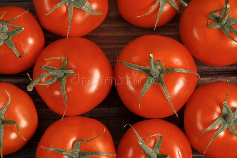 Tomatoes on a wood table stock photos
