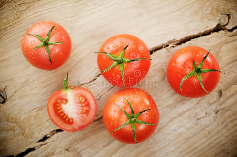 Tomatoes on wooden background stock photo