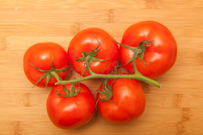 Tomatoes on wooden background. Shot of tomatoes on wooden background royalty free stock photography