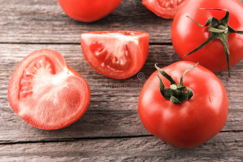 Tomatoes on a wooden board stock photos