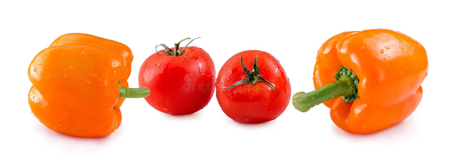 Tomatoes and Yellow Bell Pepper with drops isolated on white background. Panorama website header banner stock photo