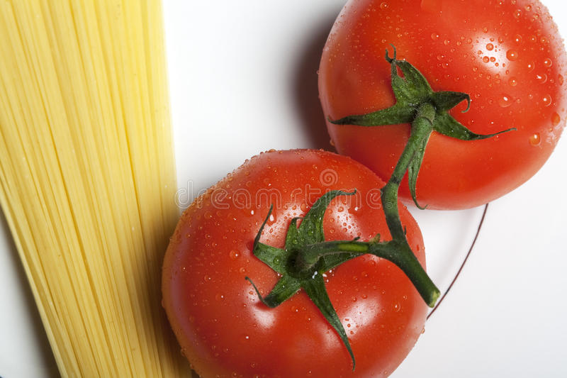 Download Tomatos and pasta stock photo. Image of board, fruit, white - 9726056