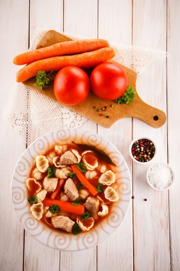 Tomatsoppa och ingredienser royaltyfria bilder