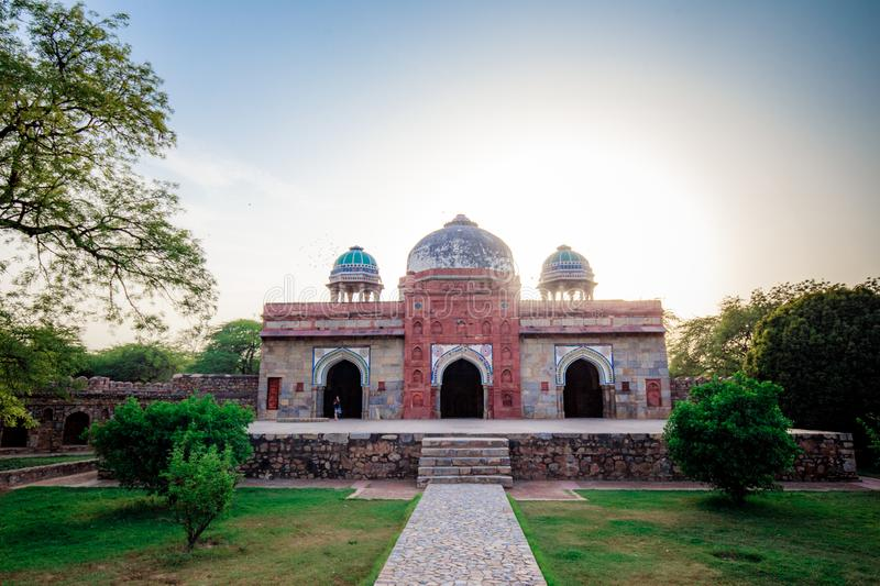 Tomb of Isa Khan in Delhi, India. Tomb of Isa Khan on Humayun`s Tomb complex in Delhi, India with beautiful sky and garden view stock photo