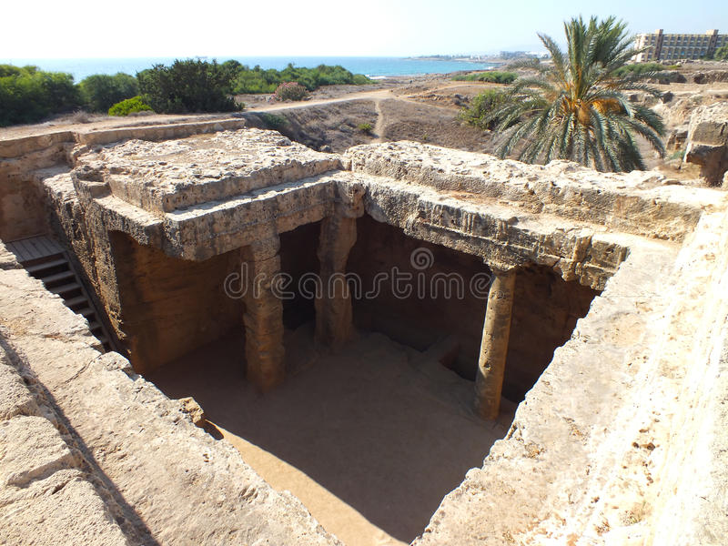 Tomb of the Kings. The tombs of the kings in Paphos, Cyprus. A contrast with the modern in the background and the ancient. Here many noble people were believed stock photos