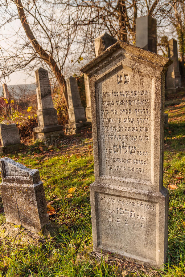 Tomb stone at jewish cemetery below medieval castle Beckov royalty free stock images